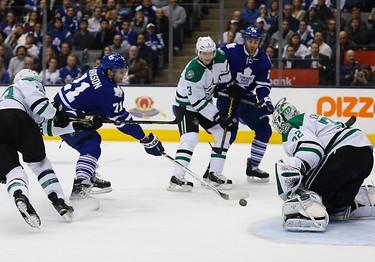 David Clarkson in on Kari Lehtonen as the Toronto Maple Leafs host the Dallas Star in an NHL regular season game at the Air Canada Centre in Toronto on Tuesday December 2, 2014. Michael Peake/Toronto Sun/QMI Agency