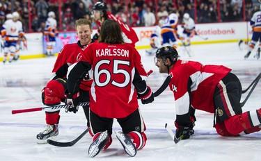 Daniel Alfredsson stretches with Erik Karlsson and Chris Phillips as he skates with the Ottawa Senators one last time in Ottawa on Thursday December 4, 2014. Errol McGihon/Ottawa Sun/QMI Agency