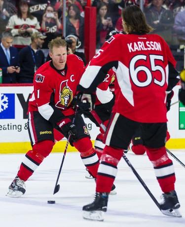 Daniel Alfredsson skates with Erik Karlsson during pre-game warmup with the Ottawa Senators one last time in Ottawa on Thursday December 4, 2014. Errol McGihon/Ottawa Sun/QMI Agency