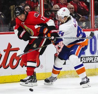 Ottawa Senators' David Legwand battles with New York Islanders' Calvin de Haan during NHL hockey action at the Canadian Tire Centre in Ottawa, Ontario on Thursday December 4, 2014. Errol McGihon/Ottawa Sun/QMI Agency