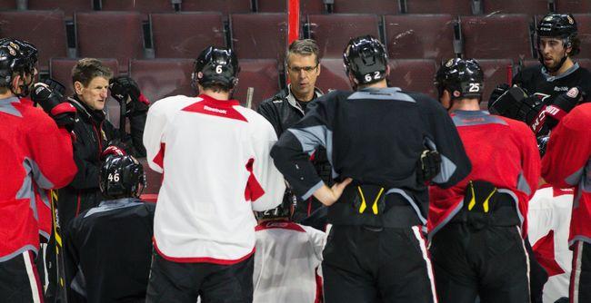 Ottawa Senators new head coach Dave Cameron   talks to his players during team practice at the Canadian Tire Centre in Ottawa on Tuesday December 9, 2014. Errol McGihon/Ottawa Sun/QMI Agency