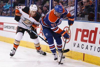 Edmonton forward David Perron (57) and Anaheim defenceman Clayton Stoner (3) battle during the first period of a NHL hockey game between the Edmonton Oilers and Anaheim Ducks at Rexall Place in Edmonton, Alta., on Friday, Dec. 12, 2014. Ian Kucerak/Edmonton Sun/ QMI Agency