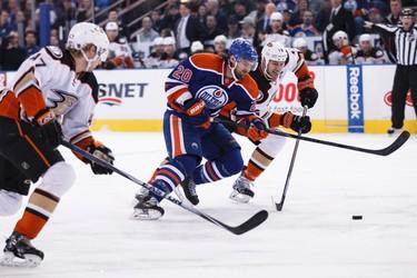 Edmonton forward Luke Gazdic (20) and Anaheim centre Ryan Getzlaf (15) battle during the first period of a NHL hockey game between the Edmonton Oilers and Anaheim Ducks at Rexall Place in Edmonton, Alta., on Friday, Dec. 12, 2014. Ian Kucerak/Edmonton Sun/ QMI Agency