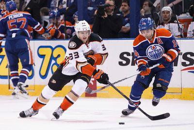 Edmonton forward Jordan Eberle (14) and Anaheim forward Jakob Silfverberg (33) battle during the first period of a NHL hockey game between the Edmonton Oilers and Anaheim Ducks at Rexall Place in Edmonton, Alta., on Friday, Dec. 12, 2014. Ian Kucerak/Edmonton Sun/ QMI Agency