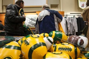 Shoppers look over Esks clothing during the Edmonton Eskimos Locker Room Sale at Commonwealth Stadium in Edmonton, Alta., on Saturday, Dec. 13, 2014. Ian Kucerak/Edmonton Sun/ QMI Agency