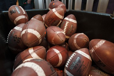 Game used balls are seen during the Edmonton Eskimos Locker Room Sale at Commonwealth Stadium in Edmonton, Alta., on Saturday, Dec. 13, 2014. Ian Kucerak/Edmonton Sun/ QMI Agency