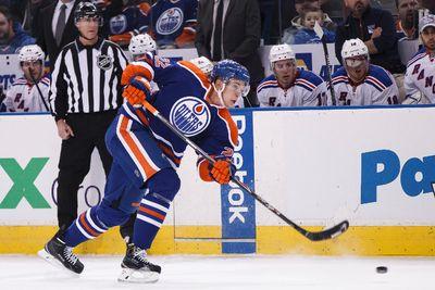 Edmonton defenceman Keith Aulie (22) shoots on New York goaltender Henrik Lundqvist (30) during the first period of a NHL hockey game between the Edmonton Oilers and New York Rangers at Rexall Place in Edmonton, Alta., on Sunday, Dec. 14, 2014. Ian Kucerak/Edmonton Sun/ QMI Agency