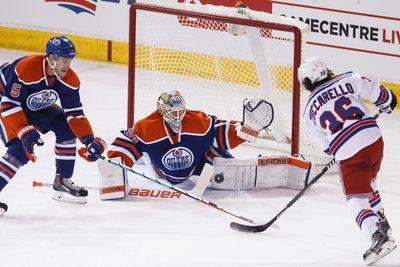 Edmonton goaltender Ben Scrivens (30) stops New York forward Mats Zuccarello (36) during the second period of a NHL hockey game between the Edmonton Oilers and New York Rangers at Rexall Place in Edmonton, Alta., on Sunday, Dec. 14, 2014. Ian Kucerak/Edmonton Sun/ QMI Agency