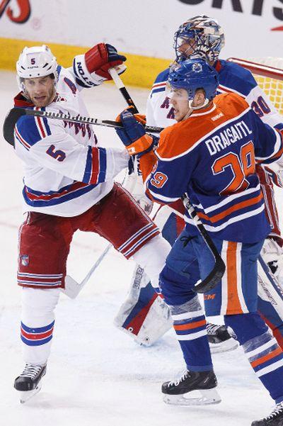 Edmonton centre Leon Draisaitl (29) and New York defenceman Dan Girardi (5) battle during the third period of a NHL hockey game between the Edmonton Oilers and New York Rangers at Rexall Place in Edmonton, Alta., on Sunday, Dec. 14, 2014. Ian Kucerak/Edmonton Sun/ QMI Agency