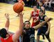 Delhi Raider captain Rodney Boodram blocks a shot from Waterford's Tyler Dewaele during NSSAA senior boys basketball regular season play in Delhi Tuesday. Boodram had 10 points in a 44-40 win for the Raiders. (JACOB ROBINSON Simcoe Reformer)