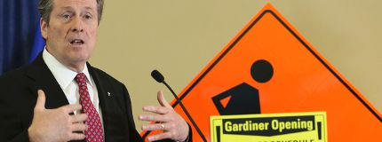 Mayor John Tory makes the announcement regarding the Gardiner Expressway on Thursday, Dec. 18, 2014. (VERONICA HENRI/Toronto Sun)