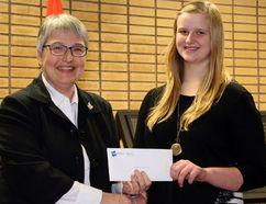Brianna Klassen presented Many Hands Treasurer Edith Lovatt with a cheque for $2,000 towards their milk voucher program. (ANDREW PRUDEN/Morden Times)