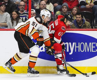 Ottawa Senators' Erik Karlsson battles with Anaheim Ducks' Dany Heatley during NHL hockey action at the Canadian Tire Centre in Ottawa, Ontario on Friday December 19, 2014. Errol McGihon/Ottawa Sun/QMI Agency