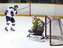 Kirkland Lake Gold Miner Ryan Aubertin scores this third period goal during the third period of Friday night's win over Powassan.