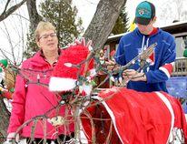Susan Punkari, and her son Brett, ensure their moose looks sharp for Christmas.