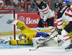 Canada's #17 Connor McDavid shoots on Sweden's goaltender #1 Samuel Ward during third period pre-tournament IIHF hockey at the Canadian Tire Centre in Ottawa on Sunday, Dec. 21, 2014. (Matthew Usherwood/QMI Agency)