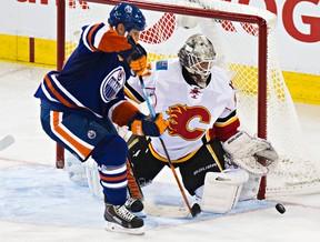 Edmonton's Matt Hendricks (23) can't get past Calgary's goalie Karri Ramo (31) during the third period of the Edmonton Oilers' NHL hockey game against the Calgary Flames at Rexall Place in Edmonton, Alta., on Thursday, Oct. 9, 2014. The Flames won 5-2. Codie McLachlan/Edmonton Sun/QMI Agency