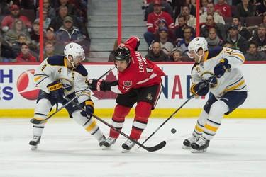 Dec 29, 2014; Ottawa, Ontario, CAN; Ottawa Senators center David Legwand (17) blocks a shot from Buffalo Sabres defenseman Josh Gorges (4) in the second period at the Canadian Tire Centre. Mandatory Credit: Marc DesRosiers-USA TODAY Sports