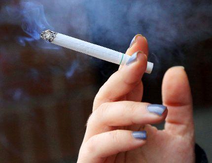 <p>A woman smokes a menthol cigarette. New regulations regarding smoking came into effect in Ontario on Jan. 1.</p><p>Luke Hendry/QMI Agency