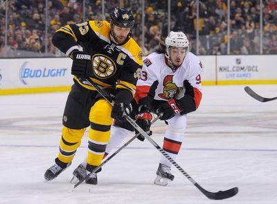 Jan 3, 2015; Boston, MA, USA; Boston Bruins defenseman Zdeno Chara (33) and Ottawa Senators center Mika Zibanejad (93) battle for the puck during the first period at TD Banknorth Garden. Mandatory Credit: Bob DeChiara-USA TODAY Sports
