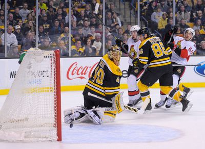 Jan 3, 2015; Boston, MA, USA; Ottawa Senators left wing Mike Hoffman (68) scores a goal past Boston Bruins goalie Tuukka Rask (40) during the third period at TD Banknorth Garden. Mandatory Credit: Bob DeChiara-USA TODAY Sports
