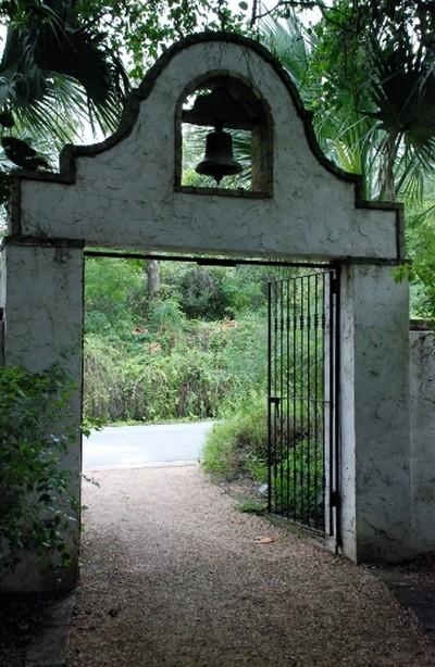 A birding path leads to a stone gateway at Quinta Mazatlan, an historic adobe mansion in McAllen, Texas. WAYNE NEWTON PHOTO