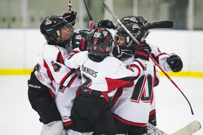 The Swat Crushers celebrate their win against the North Seera Thunder during 2015 Quikcard Edmonton Minor Hockey Week play at Mill Woods Recreation Centre twin arenas in Edmonton, Alta., on Monday, Jan. 12, 2015. Minor hockey week runs from Jan. 9 - 18, 2015. Ian Kucerak/Edmonton Sun/ QMI Agency