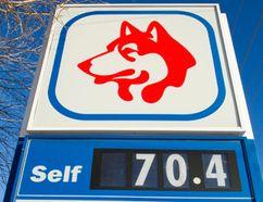 A Husky gas station at Wayne Gretzky Drive and 118 Avenue in Edmonton advertises a regular gas price of 70.4 cents on Monday, Jan. 12, 2015. (Ian Kucerak/Edmonton Sun/ QMI Agency)