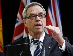 Canada's Finance Minister Joe Oliver speaks to the media in Ottawa, Dec. 15, 2014. (CHRIS WATTIE/Reuters)