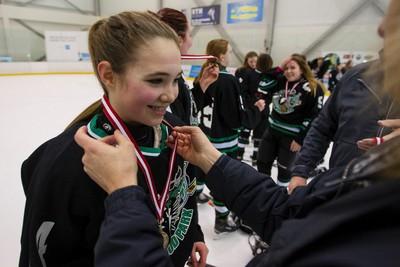 Bantam B Sherwood Park Rage Reagan Korber gets a gold medal after her team won a gold medal game against the EMHA Warriors during the final day of play at the 2015 Quikcard Edmonton Minor Hockey Week at Terwillegar Recreation Centre in Edmonton, Alta., on Sunday, Jan. 18, 2015. Ian Kucerak/Edmonton Sun/ QMI Agency