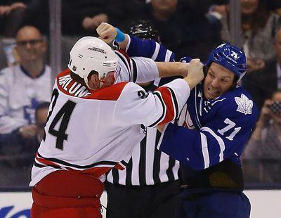 Leafs David Clarkson fights Brad Malone as Maple Leafs host the Carolina Hurricanes at the Air Canada Centre in Toronto on Monday January 19, 2015. Michael Peake/Toronto Sun/QMI Agency