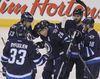 Blake Wheeler & his Jets teammates celebrate his first-period goal on Wednesday. (BRIAN DONOGH/Winnipeg Sun)