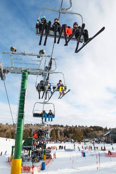 Skiers and snowboarders ride the chair lift at Snow Valley Ski Club in Edmonton, Alta., on Sunday, Jan. 25, 2015. Ian Kucerak/Edmonton Sun/ QMI Agency