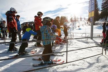 Skiers and snowboarders board the chair lift at Snow Valley Ski Club in Edmonton, Alta., on Sunday, Jan. 25, 2015. Ian Kucerak/Edmonton Sun/ QMI Agency