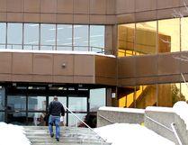 A man walks towards the main entrance at Civic Centre.