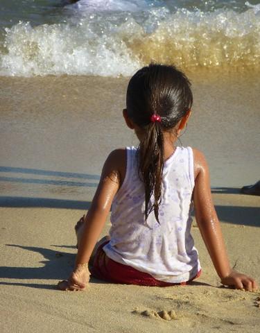 A young girl enjoys the surf at Playa Angelito, a good swimming beach near Puerto Escondido, Mexico. ROBIN ROBINSON/TORONTO SUN