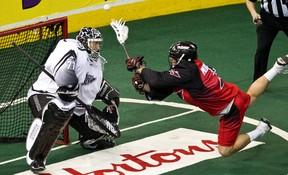 Edmonton's Aaron Bold stops Philadelphia's Brendan Mundorf during the Edmonton Rush NLL lacrosse game against the Philadelphia Wings at Rexall Place in Edmonton on Friday, February 24, 2012. CODIE MCLACHLAN/EDMONTON SUN