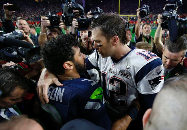 New England Patriots quarterback Tom Brady greets Seattle Seahawks quarterback Russell Wilson after Super Bowl XLIX at University of Phoenix Stadium on Feb. 1, 2015. (Mark J. Rebilas/USA TODAY Sports)