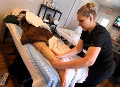 World's Longest Hockey Game volunteer and registered massage therapist, Kerstin Pelletier, rubs down a player's leg  in between the action at Saiker�s Acres, 52269 Range Road 220, in Sherwood Park, AB on Friday, February 13, 2015. TREVOR ROBB/EDMONTON SUN/QMI AGENCY