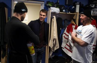 Edmonton Oilers forward Taylor Hall speaks with former Oiler Janne Niinimaa, left and World's Longest Hockey Game founder Brent Saik in the locker room at Saiker�s Acres, 52269 Range Road 220, in Sherwood Park, AB on Friday, February 13, 2015. TREVOR ROBB/EDMONTON SUN/QMI AGENCY