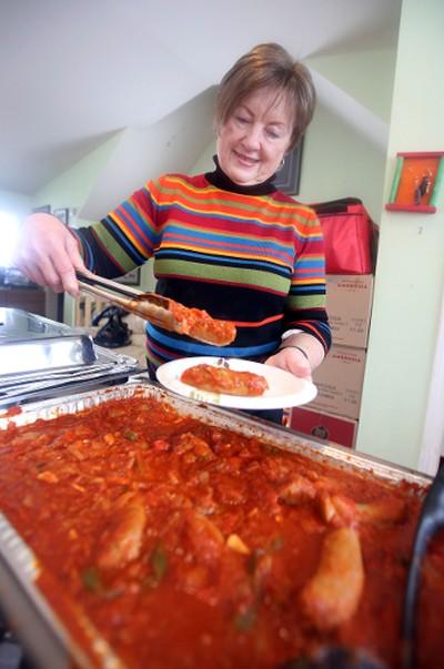 Kitchen volunteer Betty Saskiw serves up some lunch at the World Longest Hockey Game attempt at Sherwood Park, Alberta on Wednesday Feb.11, 2015. Perry Mah/Edmonton Sun/QMI Agency