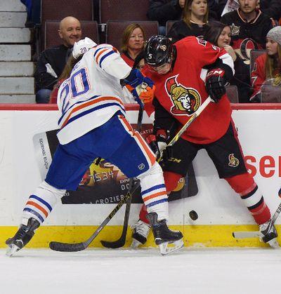 Ottawa Senators� #5 Cody Ceci battles with Edmonton Oilers� #20 Luke Gazdic for the puck during first period NHL hockey at the Canadian Tire Centre in Ottawa on Saturday, February 14, 2015. Matthew Usherwood/Ottawa Sun/QMI Agency