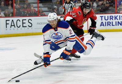Ottawa Senators� #93 Mika Zibanejad trips Edmonton Oilers� #2 Jeff Petry during first period NHL hockey at the Canadian Tire Centre in Ottawa on Saturday, February 14, 2015. Matthew Usherwood/Ottawa Sun/QMI Agency