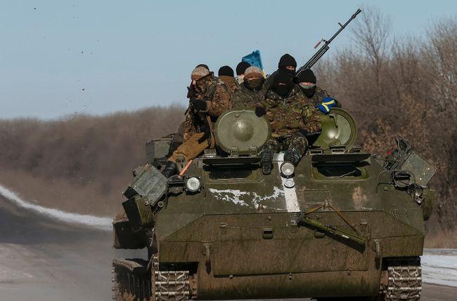 Members of the Ukrainian armed forces ride on a military vehicle near Debaltseve, eastern Ukraine, Feb. 17, 2015. (REUTERS/Gleb Garanich)