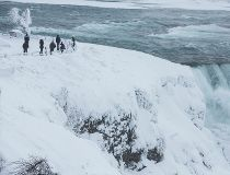 Visitors view Niagara Falls in sub freezing temperatures in Niagara Falls New York