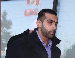 Const. Sameer Kara leaves court on Thursday, Feb. 19, 2015. (VERONICA HENRI/Toronto Sun)