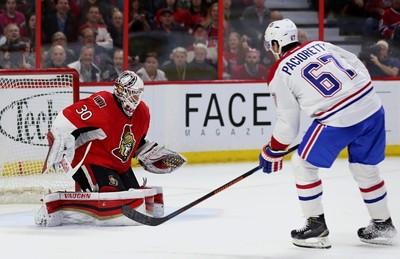 Ottawa Senators goaltender Andrew Hammond us scored on by Montreal Canadiens Max Pacioretty during NHL hockey action at the Canadian Tire Centre on Wednesday February 18, 2015. Errol McGihon/Ottawa Sun/QMI Agency