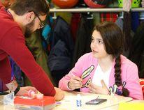 Student teacher Mathieu Robichaud talks to Maryam, a Grade 6 student at Saint Charles Garnier Catholic School in Toronto on Feb. 17, 2015. (Michael Peake/Toronto Sun)