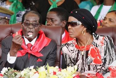 Grace Mugabe looks on next to her husband Zimbabwe President Robert Mugabe during his 91st birthday celebration in Victoria Falls February 28, 2015. REUTERS/Philimon Bulawayo