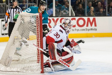 Feb 28, 2015; San Jose, CA, USA; Ottawa Senators goalie Andrew Hammond (30) blocks a shot by San Jose Sharks center Patrick Marleau (12) during the first period at SAP Center at San Jose. Mandatory Credit: Ed Szczepanski-USA TODAY Sports